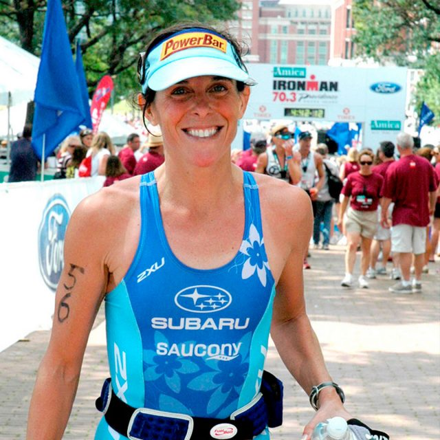 Lisa crosses Ironman Australia finish line, where she won five straight victories from 2002 through 2006