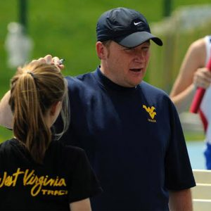 Clara confers with Coach Sean Cleary